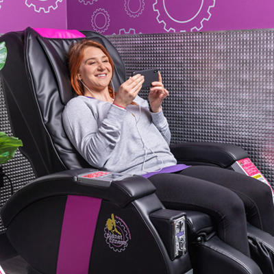 woman enjoying a massage chair